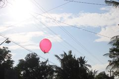 Balloon on the blue sky stock photography