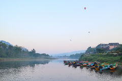 Balloon and boat on river Royalty Free Stock Photo