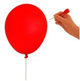 Balloon, bolha estourada - metáfora, mão e dardo Fotos de Stock Royalty Free