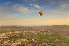 Balloon in Cappadocia over the hills Royalty Free Stock Photo