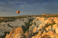 Balloon in Cappadocia over the hills Royalty Free Stock Images