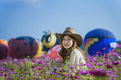 Balloon. Colorful hot air balloon flying over field of flowers Royalty Free Stock Photo