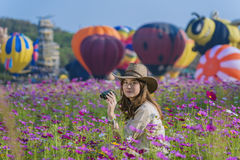 Balloon. Colorful hot air balloon flying over field of flowers Stock Image