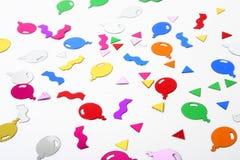 Balloon Confetti. Colorful balloon confetti isolated on white stock image
