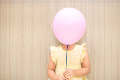 Balloon cover a girl Royalty Free Stock Photos
