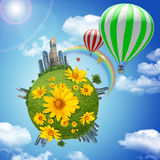 Balloon with earth and flowers Stock Images