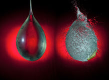 Balloon explosion. The balloon full of water is frozen before and in the moment of its explosion on the red gradient background. High speed photography royalty free stock photography