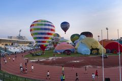 Balloon festival in stadium at daytime Stock Image