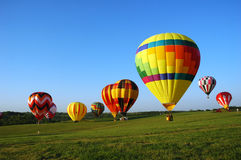 Balloon field. Hot air balloons landing in a field during a festival in Iowa royalty free stock images
