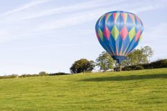 Balloon in Field. Hot air balloon in a sunny field Stock Photo