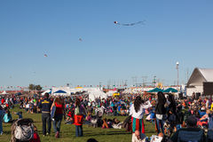 Balloon Fiesta. Albuquerque, NM, October 4, 2014: A large crowd of people, some flying kites,  enjoy the festivities at the Balloon Fiesta on October 4th, 2014 Royalty Free Stock Image