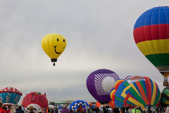 Balloon Fiesta 2014. Albuquerque, NM, October 8:  A smiley face balloon floats above others not yet launched at the Balloon Fiesta in Albuquerque, New Mexico on Stock Photography