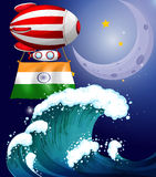A balloon with the flag of India above waves Stock Image
