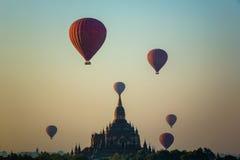 Balloon flies over Sulamani Guphaya temple at dawn Stock Photo