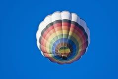 Balloon flight. Balloon colors of the rainbow in flight Stock Photos
