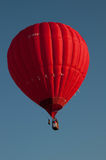Balloon flight. Lone balloon soaring in the sky Stock Photo