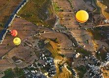 Balloon flight over ancient rocks and fields at Cappadocia, Turkey Stock Photo