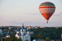 Balloon flight. Over the city and the church Stock Photos