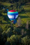 balloon in flight over the forest stock photo