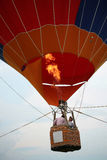 Balloon flight. The pilot turned on the gas burner to fill a hot air balloon Royalty Free Stock Photos