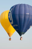 Balloon flight. Two balloons floating in the sky Stock Images