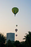 Balloon floating to sky over city Royalty Free Stock Photos