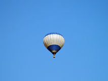 Balloon floats in the blue sky Stock Image