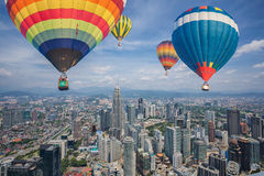 Balloon fly over Kuala Lumpur city skyline and skyscrapers Royalty Free Stock Image