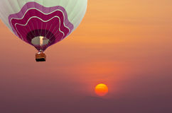 Balloon fly in the sunrise Royalty Free Stock Image