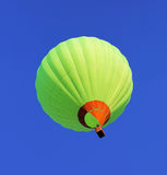 Balloon flying in blue sky Royalty Free Stock Photography