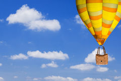 Balloon flying on blue sky. Background Royalty Free Stock Photography