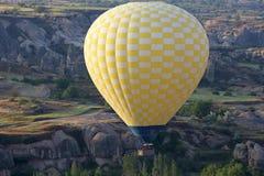 Balloon is flying in mountainous area in Cappadocia. Turkey Royalty Free Stock Image