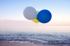 Balloon flying near the beach Royalty Free Stock Images