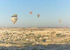 Balloon flying over Cappadocia Stock Photo
