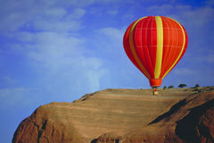 Balloon flying over Red Rock, New Mexico Royalty Free Stock Images