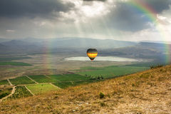 The balloon is flying over the Valley near the village of Kokteb Royalty Free Stock Images