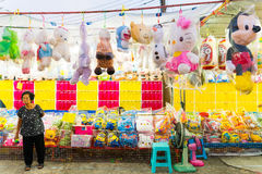 Balloon game and doll prize at Temple fair in Bangkok, Thailand Royalty Free Stock Photo