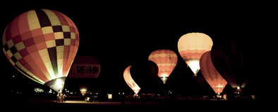 Balloon Glow. Hot air balloons use there fuel tanks to illuminate the balloons in the night sky. (Image taken from color negative Royalty Free Stock Photography