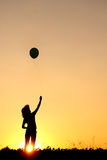 Balloon and happy woman on sunset silhouette stock photos