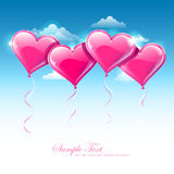 Balloon hearts upon blue sky Stock Images