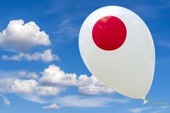 Balloon with the image of the national flag of Japan, flying through the blue sky. 3D rendering, illustration with copy space stock photo