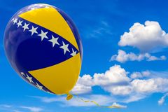 Balloon with the image of the state flag of Bosnia and Herzegovina against the blue sky. 3D render, illustration with copy space royalty free stock photography