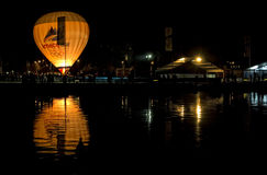 Balloon and its reflection at Annecy lake. Royalty Free Stock Images