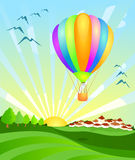 Balloon landing at dawn Royalty Free Stock Image