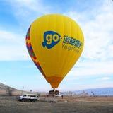 A balloon landing after flight in Cappadocia, Turkey Royalty Free Stock Photos