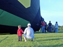 Balloon Launch 4. Father and son watch an early morning hot air balloon launch Royalty Free Stock Photos