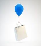 Balloon lifting a shopping bag Stock Photo