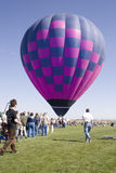 Balloon liftoff. A balloon preparing to liftoff Stock Photo