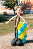 Balloon man dolly in the summer sun on school garden stock photo