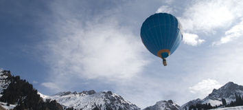 Balloon in the mountain sky stock image